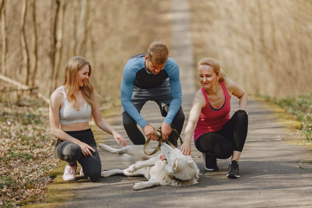 Happy family doing some walking with their dog