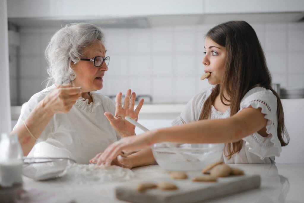 Grandmother and granddaughter making some cookies