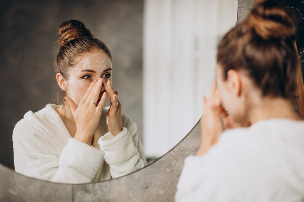 Woman putting moisturizer on her face